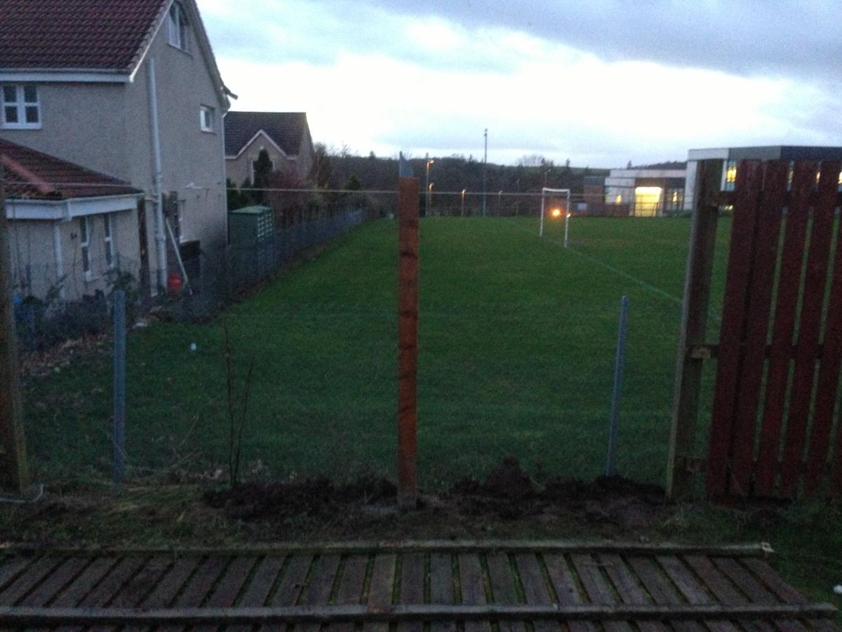 New post and fence on the ground