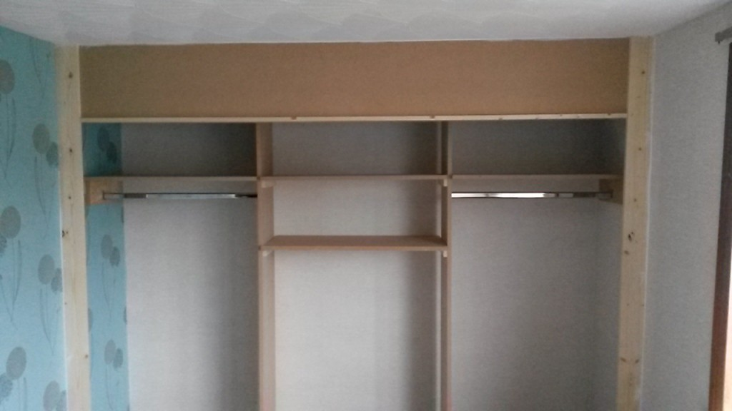 Wardrobe with shelving and rails